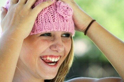Girl Laughing Hat, gummy smile.