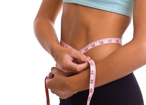a flat stomach with neasuring tape around it symbolic of losing weight without surgery