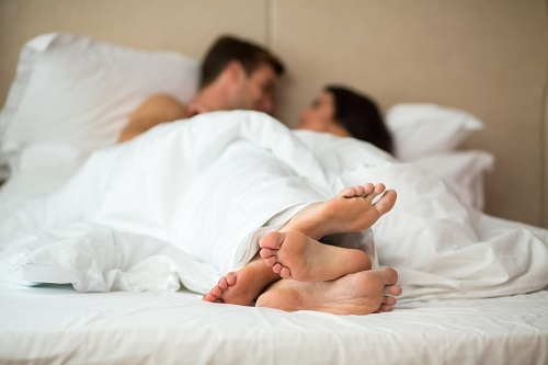 Couple in bed - concept photo for erectile dysfunction treatment.