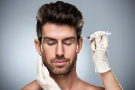 man receiving a botox injection in his forehead