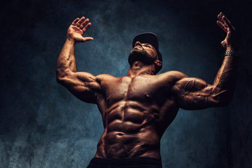 A male body builder's half body shot.
