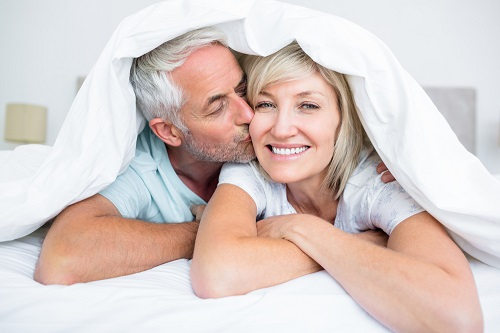 a picture of an older couple under bedsheets