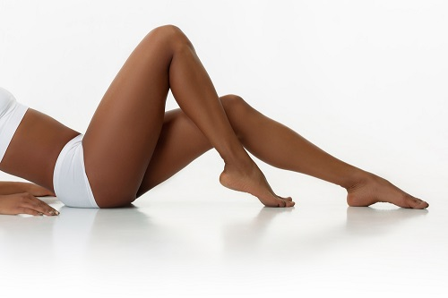 close up of long dark skin legs