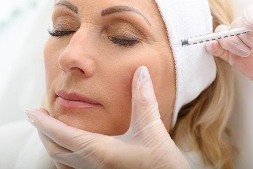 an older woman having cheek augmentation surgery.