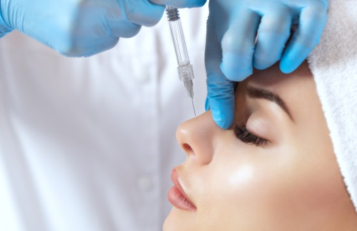 a patient having nose reshaping treatment